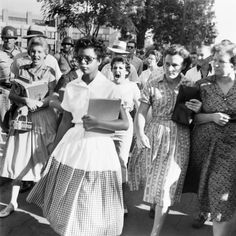 "In this 1957 picture, Elizabeth Eckford of what became known as ""The Little Rock Nine"" is seen being followed and threatened by an angry white mob on her way to class, as one of the first African-American students to ever attend classes at Little Rock Central High School in Little Rock, Arkansas."
