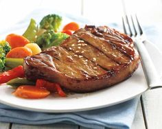 Korean BBQ Pork Chops Recipe - Enhance the depth and intensity of our bone-in pork chops with Asian BBQ flavors of soy sauce, sesame and ginger. Remember, the longer you marinate the pork chops the more intense the flavor. A garnish of sesame seeds completes this authentic Korean favorite. #Schwans #EasyRecipes #Inspiration