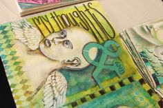 Inside pages of Pam Carriker's personal journal using face masks from her class at Art Journaling Live.