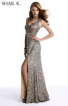 This floor length, formal evening dress stands alone with its incredibly distinct hand beaded pattern accentuated form the waistline up. Its fitted waist, full coverage neckline and wide straps flatter any-body. The thigh high slit with open back adds the right amount of sexy to this timeless dress.