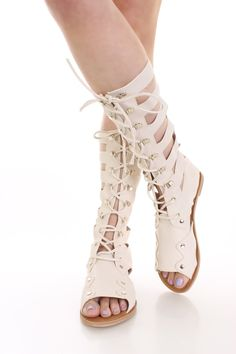 Look perfectly pretty for your next party when you add these saucy gladiator sandals to your look! They go perfect with any outfit for any occasion! Make sure you add these to your closet, it definitely is a must have! Featuring open toe, patent faux leather, strappy sides, lace up, back zipper, smooth lining, and cushioned footbed. Approximately 12 inch shaft and 12 inch circumferences