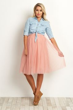 This oh-so-feminine tulle maternity skirt is the perfect addition to your wardrobe this year. A pretty tulle mesh fabric and midi style fit gives you a piece you can layer over any tank, crop top, or even a long sleeve sweater. With this gorgeous skirt, there are endless possibilities for a stylish and chic look.