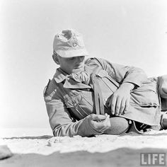 A German soldier relaxing in the desert