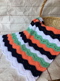 Peach, mint green and navy blue Crocheted baby blanket. This is a very special handmade crochet baby blanket.  This baby afghan will make a wonderful baby shower gift.  This blanket would make a lovely addition to your baby nursery decor. Perfect also, for travel, strollers, prams, cribs, tummy time and photo props