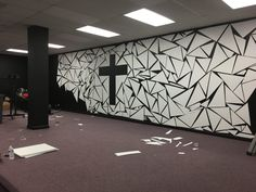 Mason McGill fromKingdom Empowerment Christian Church inDover, Delaware brings us this cool fragmented Coroplast design.They painted the stage in a flat black ($54) to give them the base for the design. They also purchased 100 sheets of 24x18' Coroplast ($106.00) and cut them in different sizes and shapes as they designed it all around the cross.They used eight 86 RGB Stage Light Par DMX-512 for uplighting ($104.95). To complete the look, they mounted flat screens (already owned) on eac...