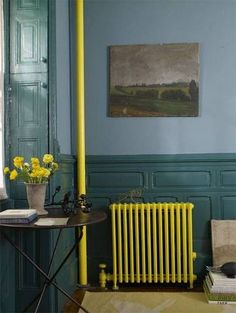 A bright pop of color reserved for the room's unsightly elements can transform them into a dynamically accented touch.