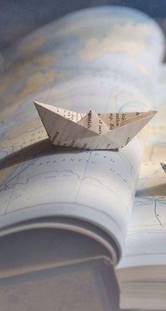 paper boat on atlas