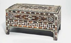AN OTTOMAN MOTHER-OF-PEARL AND TORTOISESHELL INLAID SCRIBE'S TABLE TURKEY, 18TH CENTURY. Price Realized $9,163 Estimate $7,636 - $11,454