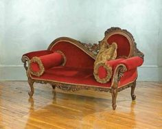"""Scarlett Fainting Chaise    Sumptuous velvets and embellishments are experiencing a renaissance...creative, posh, and  the ultimate perch for a diva or drama queen to read and dream. Hand carved mahogany. 39½ x 65½ x 26½""""."""