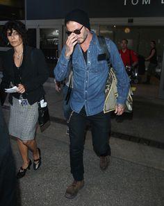 GQ.com: David Beckham in Los Angeles, CAVery into the black shirt under the denim shirt. Crispy..