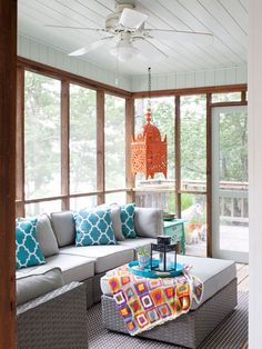 This Lake Lanier wheelchair accessible screened-in porch just pops with color accents! Interior designer: Beth Johnson
