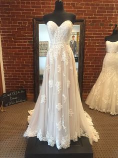 Light and airy boho wedding dress by Stella York. Lace appliqués cascade down a frothy tulle skirt. Finished with a beaded belt that accents the waist. #weddingdress
