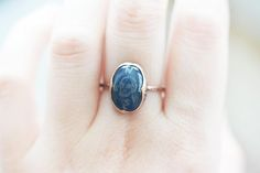 This is a unique copper and engraved blue chalcedony ring made in my studio. The chalcedony is oval shaped and dark, almost navy blue! I have engraved it with a skull drawing and North, South, East, West signs! This is a unique symbolic moral compass ring :) The setting is made out of copper and it is also shaped in a way so that it points to N, S, E, W! :) The ringband is also solid copper, and all the copper has a bit of patina and rustic look. This would make a good travel ring! Stone…