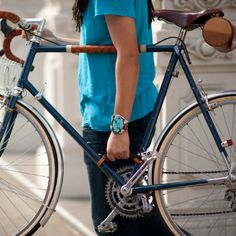 """Bike Frame Handle -- The original bicycle frame handle launched by us on Kickstarter. The frame handle (a.k.a. """"The Little Lifter""""!)  is a comfortable, stylish, sturdy, and easy-to-use leather handle for carrying your bicycle, whether it's up the stairs, across the tracks, or onto the metro."""
