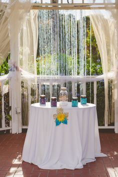 sand ceremony with diy decorated mason jars and sand in wedding colors. Rustic fall autumn October central Florida wedding. Gazebo decorated with diy tulle and bead strands