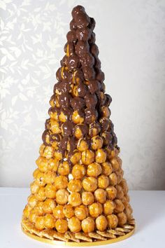 Chocolate Drizzle Croquembouche. Also known as a pièce montée, a croquembouche is a traditional French wedding cake which has become quite fashionable in England. - http://www.lepapillonpatisserie.com/wedding-cakes/chocolate-drizzle-croquembouche/#
