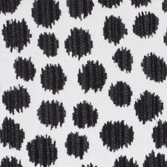 Sarah Spot Outdoor Fabric A playful woven fabric with striped animal spots in contrasting black and charcoal on an off-white ground.