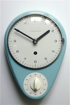 "Wall-kitchen clock with timer by Max Bill for Junghans 1956/57    ""Max Bill was the single most decisive influence on Swiss graphic design beginning in the 1950s with his theoretical writing and progressive work. His connection to the days of the Modern Movement gave him special authority. As an industrial designer, his work is characterized by a clarity of design and precise proportions. Examples are the elegant clocks and watches designed for Junghans, a long-term client"" Wikipedia"