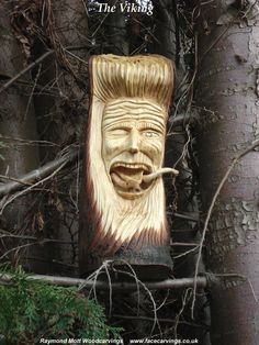 THE VIKING woodcarving with snakes coming out of mouth