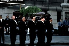 Jacqueline Kennedy Onassis' casket is taken from the funeral home.