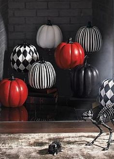 Show your Halloween spirit without the mess of carving with the stylish Designer Pumpkin that brings sophistication to your haunting decor.