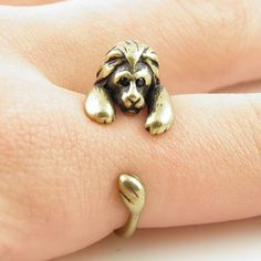 Roar!!!! This gold lion wrap ring is slightly adjustable with a gentle squeeze. It fits a size 5-9. He is sweet with Swarovski Crystal eyes, full mane and little ears as this little guy wraps around