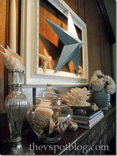 The Mantel From Hell: summer edition: turquoise, mantel, frame, white, star, shells, silver