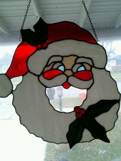 My very first stained glass project. Santa wreath.
