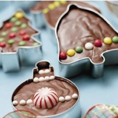Bake brownies right into cookie cutters, decorate, and then give away as neighbor gifts with the cookie cutters as part of the gift. :) Great idea!