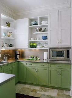 "Soft Green and White Kitchen Cabinets. I'd use Benjamin Moore in ""Spring Meadow"" #486 because it's almost the exact color of my hutch."