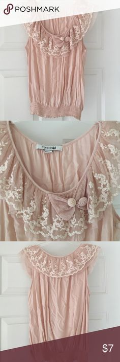 Vintage, lace rimmed top Pretty pink, lace around neckline with bow. Cinched bottom. Says large, but fits like a S/M Forever 21 Tops