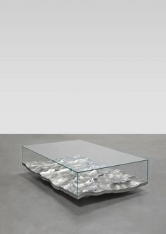 """They fix the moment as a frozen image and play with the constant reflections of light on their polished surface. Liquid creates a certain ambiguity of its materials, in a state of transition at the border of liquid and solid"" - MATHIEU LEHANNEUR - (The ""Liquid Marble"" table features convincing waves made from aluminium using 3D special effects software usually employed by the film industry. Design by Mathieu Lehanneur)"