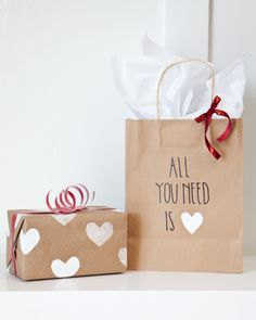 Today we're sharing our wrapping for Valentine's this year. As always, we try to keep it really easy so we brought out our kiddy selves again with the potato stamp and then a little hint of red.