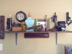 Shelf made with vintage car parts; decorated with random tools & other vintage items Vintage Car Room, Vintage Cars, Vintage Items, Antique Shops, Vintage Antiques, Classic Car Garage, Industrial Farmhouse Decor, Man Cave Room, Restaurant Ideas