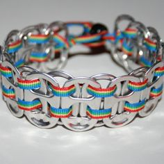 An awesome pop can tab bracelet with rainbow ribbon and a black pony bead closure. A bead closure makes this bracelet easy to put on and take off, but will stay put while youre wearing it!    If you want this bracelet, get it now! This is the last bracelet with this ribbon!!!    The bracelet fits wrists from 6.5 to 7.5 inches