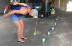 How do you play panty hose bowling, you ask? The object of the game is to knock down the most water bottles using only a ball that's inside a pair of panty hose attached to your head.