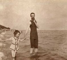 What looks to be a photo of a girl and her dad, probably early 1900's