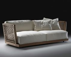 Lightening up the living room, the Oscar sofa by Flexform does away with solid armrests in favor of a frame woven with leather cord—perfect for a summer house or for a slightly more casual year-round look. Available in October; approximately $15,000, flexform.it.