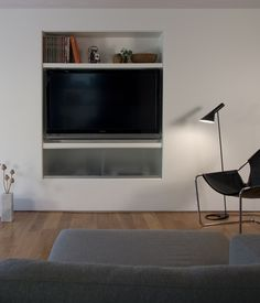 Across from the sofa and recessed into the wall is the television and media center. Franz and Pare-Mayer had to fur out the walls to insu...