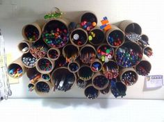 wall mounted pen/pencil holders. creative storage - Metta's art area.