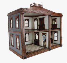 American open front dolls' house, circa 1850, with stained wood architectural detailing throughout.