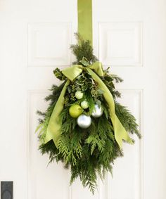 A regular round wreath isn't for everyone. Mix it up by hanging a bundle of greens with a matching silk ribbon, plus a few gleaming ornaments for good measure. It might not be traditional, but this project is just as festive. Click through for the tutorial and more DIY Christmas wreaths.