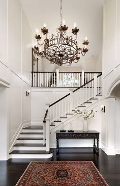 'It's a great Christmas tree house because of the foyer with the high ceilings,' says Mrs. Jaffe, age 65. The antique chandelier came from a bank in Philadelphia, says Mr. Jaffe, age 70.