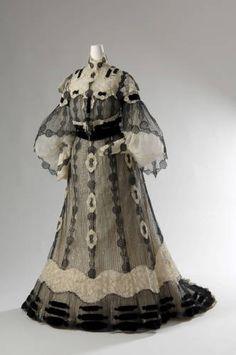 Evening dress, 1902. Silk lace, silk net, sequins, glass beads, silk velvet trim. Henriette Favre