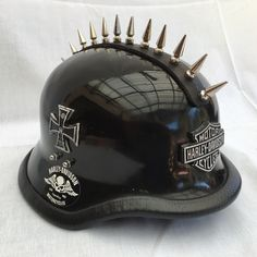 PunkStyle WW2 German Helmet. Punk studs on leather connected to helmet to create this unique Motorcycle Helmet! Manufactured from high grade glass fibre reinforced Polyester. Can be fitted with any badge.