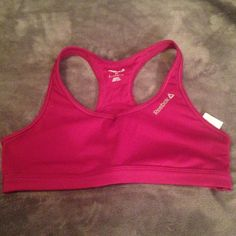 NWOT burgundy reebok sports bra (play dry) In perfect condition, never used. Beautiful, deep burgundy color. 76% polyester, 24% spandex. Reebok Other