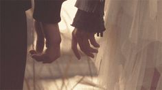 Holding hands is a clear way to depict the sense of touch