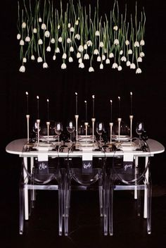 Black and white modern minimalist, danging tulips take the place of a floral centerpiece ~ http://www.modwedding.com/2015/10/10/black-and-white-wedding-inspiration-shoot/