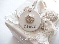 fleur Handmade Clay Tags with Linen Rose - Set of 2. $10.00, via Etsy.