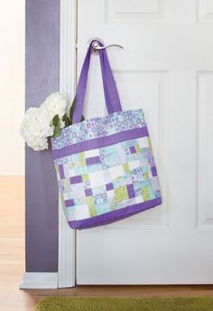 You might know how to make a patchwork quilt, but do you know how to make a patchwork tote? Designer Maria Pate likes the challenge of incorporating non-traditional materials, such as leather, into patchwork designs like this one - Lavender and Leather quilted tote.